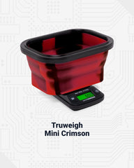 The black and red tie dye Truweigh Mini Crimson digital pocket scale is shown with the black and red silicone weighing bowl fully expanded on top of the scale. The scale is on to show the green LCD backlight.