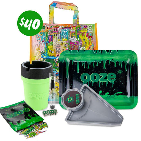 The Ooze 2020 $40 Dry Herb Grab Bag is pictured against a white background. This bundle includes the Oozeville reusable bag, Ooze logo rolling tray, grinder tray, Roadie silicone car ashtray, stickers and a hat pin.