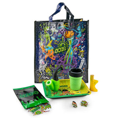 The Ooze Dry Herb Grab Bag with all contents shown outside the bag against a white background. This includes a Sax bubbler, Roadie ashtray, EZ pipe, rolling tray, sticker pack, and hat pins.