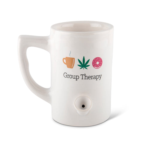 "A white ceramic mug pipe against a white background. The mug has a coffee cup, weed leaf and donut above the phrase ""Group Therapy"""