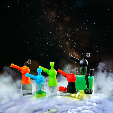 Ooze Blaster in Aqua Teal, Green Glow, Orange Burst, Scarlet Red, and Shimmer Black in front of space themed background