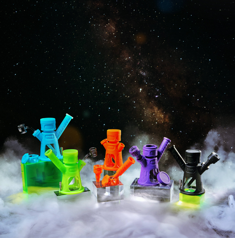 Ooze Hyborg in Aqua Teal, Green Glow, Orange Burst, Shimmer Purple, and Shimmer Black in front of space themed background