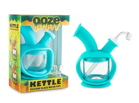 Ooze Kettle Hybrid Glass Piece in Teal. In Box on the left and out of box on right