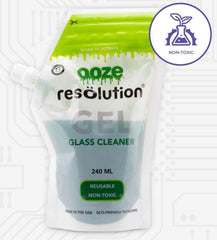 A pouch of the Ooze Resolution glass cleaning gel is shown full and zipped. There is a white and purple non-toxic call out bubble over the upper right corner.