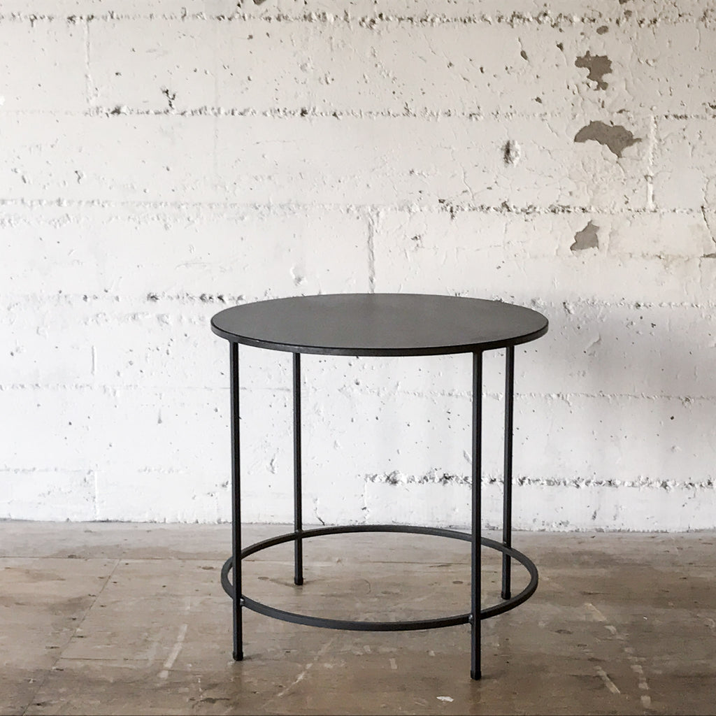 Slim Round End Table In Natural Steel