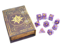 the star of azathoth polyhedral dice set with box on white