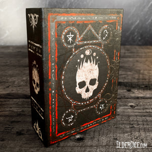 Elder Dice grimoire for the Mark of the Necronomicon blood and magic dice with bone-white paint