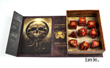 The Brand of Cthulhu polyhedral dice set pictured inside the spellbook box