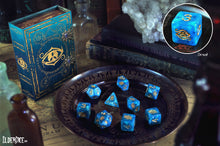 blue swirl Eye of Chaos polyhedral dice set with spellbook grimoire