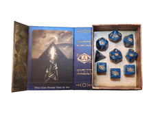 blue with gold Eye of chaos polyhedral dice set in spellbook grimoire
