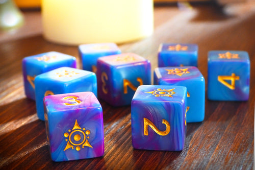 blue and pink swirled Kadathian Ice dice