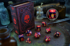 Red and Black Necronomicon dice with spellbook grimoire