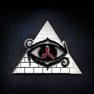 Eye of Chaos gen con collectible pin in black and red