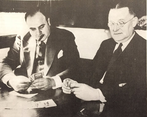 Al Capone en route to prison, playing cards with federal marshal.