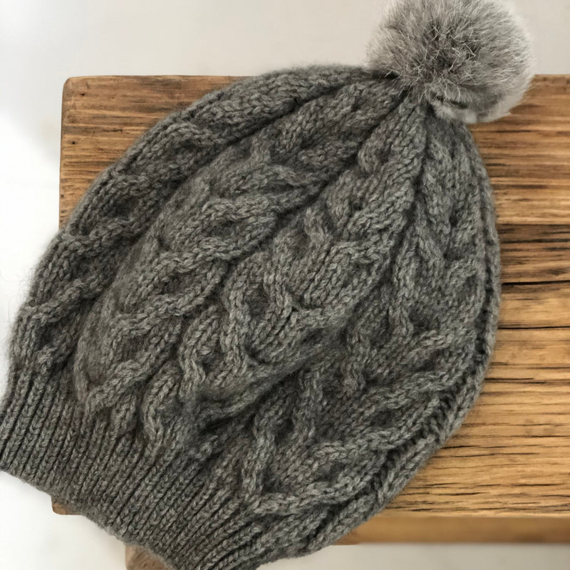 Possum Merino Cable Hat with Rabbit Pompom