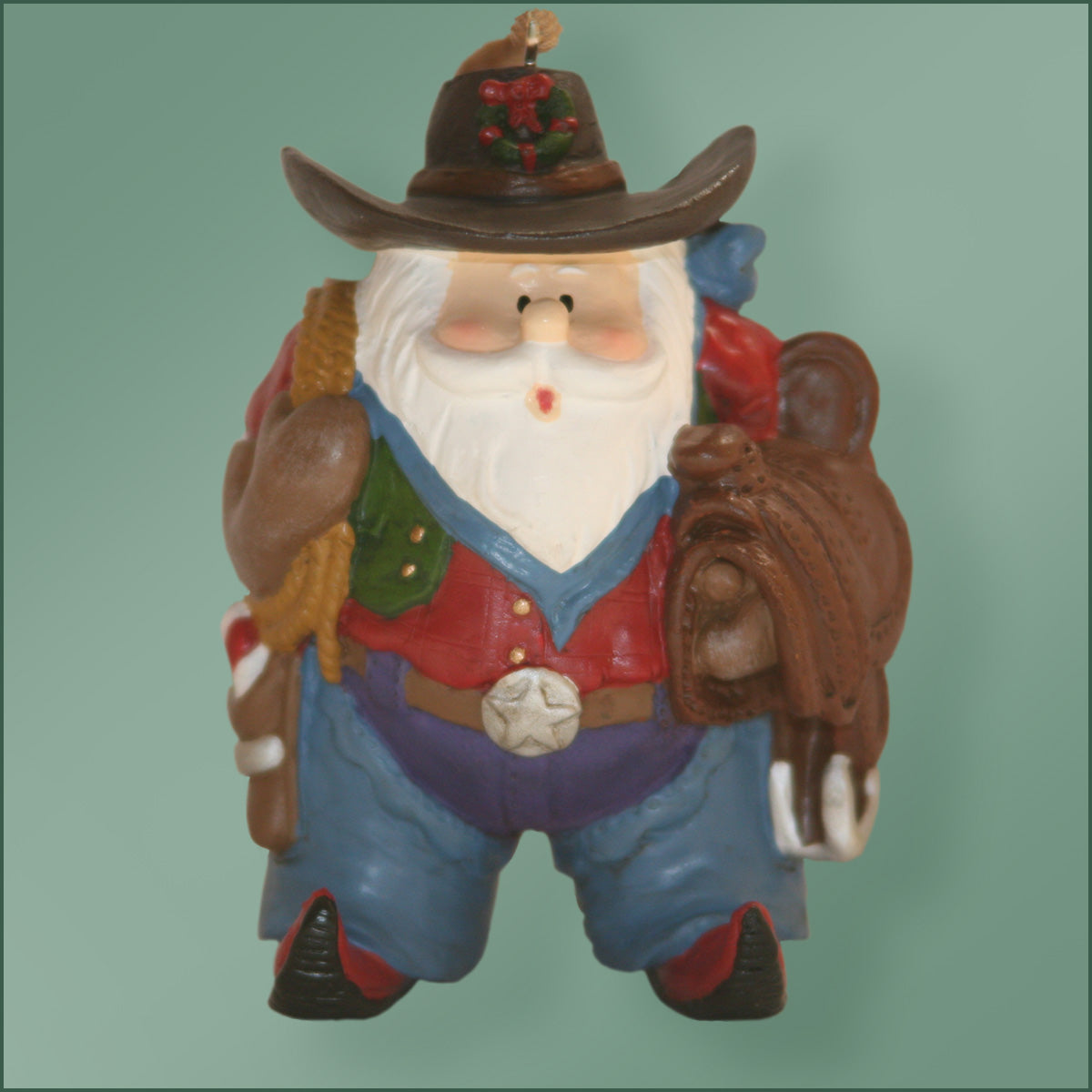 Polyresin - Santa with Saddle And Lariat