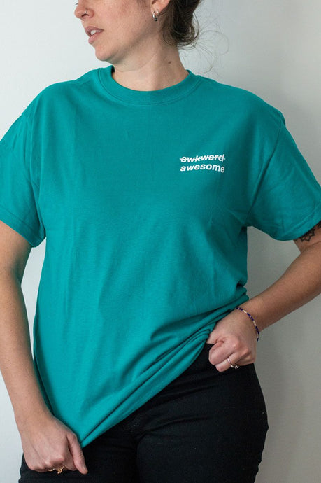 Teal tshirt with awkward awesome design.