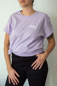 Light purple tshirt with compete collaborate design.