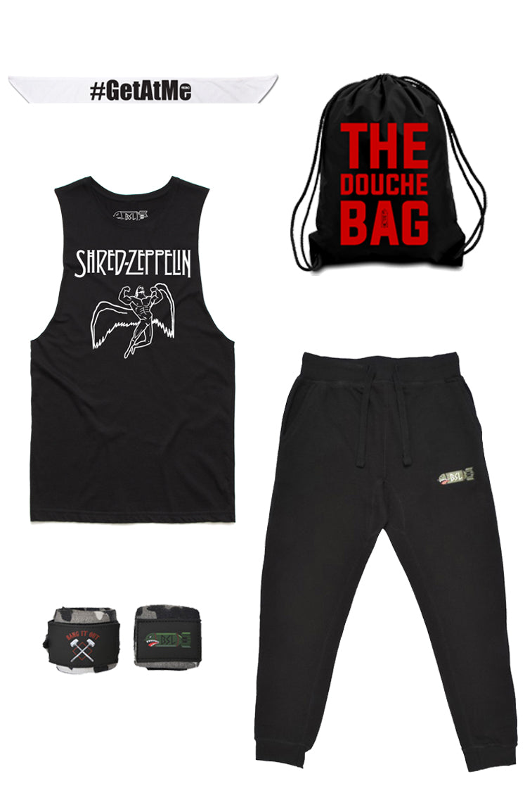 The Ultimate Dom Costume - Shred Zeppelin Cut-off, Black Joggers, White Bandana, Camo Wraps, Gym Bag