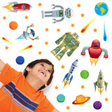 little boy looking at robots in space wall stickers set. Boy room stickers on bedroom wall.