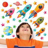Toddler looking upwards at robots in space wall stickers set. wall decals are stuck on wall above toddler.