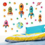Space wall stickers blasting away from earth into space. Wall decals stuck above childs bed bedroom wall.