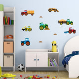 Tractor wall stickers stuck on boys bedroom wall above toy cupboard. Room has a blue theme.