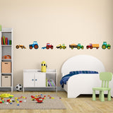 Tractor wall stickers stuck on boys bedroom wall above bed. Room has a cream theme.