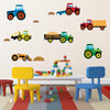 Tractor wall stickers on the wall laid out across nursery wall.