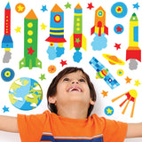 little boy looking at colourful rocket wall stickers. Decals stuck on bedroom wall.