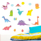 Cute dinosaur wall art stickers stuck above bed on wall. Boys bed is blue an yellow in colour.