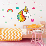 Unicorn wall stickers set has a unicorn with bright disco colour hair, placed among stars an rainbows on a bedroom wall.