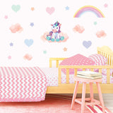 Unicorn wall stickers set depicts dreamy teddy bear unicorn sitting on clouds among stars an rainbows on a bedroom wall.
