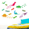 Dinosaur wall sticker set stuck on boys room wall. Bed is yellow an blue in colour.