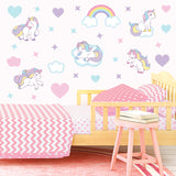 Unicorn wall sticker set depicts pastel coloured unicorns galloping among stars, clouds, rainbows on a bedroom wall.