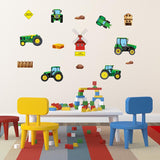 Tractor wall stickers stuck on playroom wall above desk. Room wall is cream.