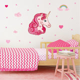 Unicorn wall stickers set has a pink curly long haired unicorn among stars, hearts, rainbows on a bedroom wall.