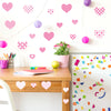 Heart wall decal pattern stickers stuck on white wall above desk. Girl theme bedroom.