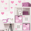 Heart wall decals pattern stickers stuck on cream wall above desk. Girl theme bedroom.