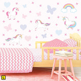 Unicorn wall stickers set has a family of playful unicorns playing among stars, hearts an rainbows on a bedroom wall L.