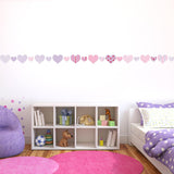 Heart wall stickers stuck on wall. Purple girl theme bedroom.