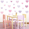 Heart wall stickers stuck on cream wall above desk. Girl theme bedroom.