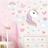 Unicorn wall sticker set depicts rainbow colour haired unicorn among rainbows, stars an clouds on a wall above draws L.