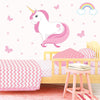 Unicorn wall stickers set has a pink colour haired unicorn standing among stars, butterflies, rainbows on a bedroom wall.