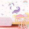 Unicorn wall stickers set has a purple colour haired unicorn standing among butterflies, stars, rainbows on a bedroom wall.