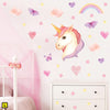 Unicorn wall stickers set has a twinkly eyed unicorn placed among hearts, butterflies, stars, rainbows on a wall above draws L.