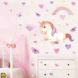 Unicorn wall stickers set has a twinkly eyed sitting unicorn among heart, butterflies, stars, rainbows on a wall above draws L.