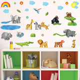 Jungle safari nursery wall stickers animals stuck on wall above toy cupboard.