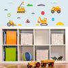 Construction wall stickers set stuck on blue playroom wall above toy cupboard.