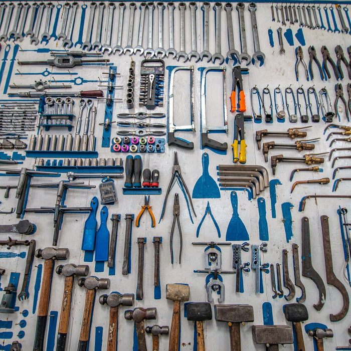 A collection of tools arranged on a table